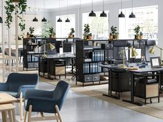Create a lush business office space with functional furniture from the IKEA BEKANT series with sit and stand desks, shelving units and smart storage. Corporate Office Design, Office Space Design, Modern Office Design, Office Interior Design, Office Interiors, Open Space Office, Open Concept Office, Industrial Office Space, Business Furniture