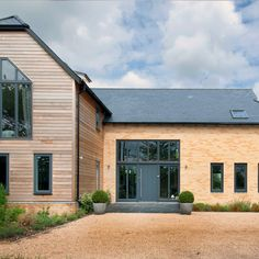 Modern country barn home with light brick and timber cladding with a grey front door. Mr & Mrs Towler built their dream home in Cambridgeshire with the help of Potton Homes, Self Build Specialists. Barn House Design, Country House Design, Home Building Design, Building A House, Wood Cladding Exterior, Cedar Cladding, House Cladding, Barn Conversion Exterior, Barn House Conversion