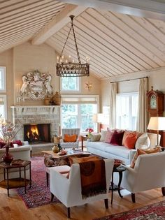 I like the color of the wash used on the walls and wood; stone fireplace and color of the floors. I would like to do this with my vaulted ceiling and dark beam in the center of my room - nice solution