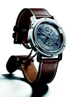 Hermes Cape Cod Watch: Swiss-made, quartz movement, with stainless steel case with silvered dial and white epsom calf leather strap here at Hermes boutique for $2,225.00. Want.....