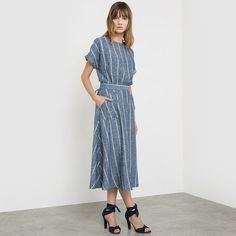 Striped Linen and Viscose Midi Dress - SOFT GREY | Linen and viscose dress with vertical stripes. Short sleeves with turn-ups. Round neckline. Halter-neck. 2-button fastening at the back of the neck. Flat inset waistband with flap that fastens at the back. Flared hem. 2 patch pockets at the front. Length 115 cm. #frenchfashion #frenchstyle