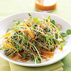 Spicy Sunflower Salad with Carrot Dressing - what a perfect spring dish!  From Cooking Light