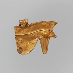 Gold Wedjat Eye Amulet, 664–380 B.C. Egypt. The Metropolitan Museum of Art, New York. Rogers Fund, 1923 (23.2.67) | The symbolism of this wedjat-eye amulet was one of the most pervasive and powerful in ancient Egypt. Combining a human eye with the stylized markings of a falcon's, it represents the eye of the god Horus, one form of the sun god.