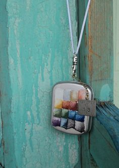 A wearable tin journal of very usable, highly addictive to use handmade watercolor paints.