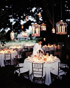 Dinner at Dusk - HANGING LATERN LOVE small and large glass laterns hang from branches by chain, holding ivory tapered candles, and rose petals