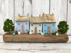 Original driftwood art by ontheTides Three little wooden houses sit on a lovely piece of driftwood found by me and our family lurcher, Bill, on one of our many walks along our local beach down here on the South Coast of England. The houses have been made using reclaimed wood and