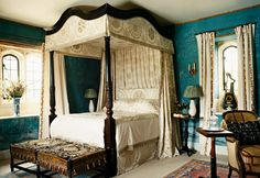 In an English castle perhaps? The bed curtains would help keep out the winter cold! Very formal, but beautiful too.