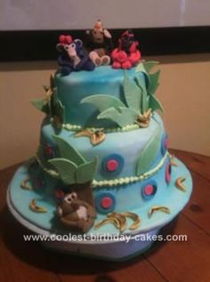 Homemade Monkey Cake: This monkey cake was made for Avery because she loves monkeys!  A 3 tier cake covered in fondant that I airbrushed in lite blue.   The monkeys were hand