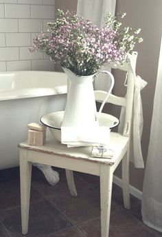 FarmhouseIdeas12- chair next to tub to hold pretty things such as pitcher of flowers and tub and soaps