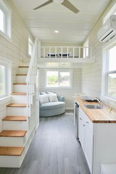 Make couch a sectional with wall covered with a bookshelf on the right. Highland Tiny House.