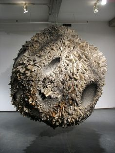 Sculptor Chun Kwang Young uses a seemingly infinite quantity of small foam wedges wrapped in Korean mulberry paper to create imposing, meteoric installations that seem to crack and splinter like fractals.