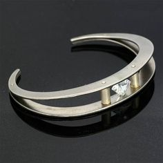 image of: Stainless Steel Bangle with spinning tension set stone