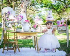 First birthday photography. First birthday photo shoot ideas. Baby girl photo ideas. Horse carousel photo ideas. 1st birthday outdoor photography. Tea party Theme first birthday. Miami Florida photographer. InesLynn Photography.