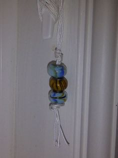 glass beads for a roman blind pull