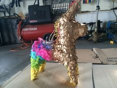 Gold piñata for baby shower