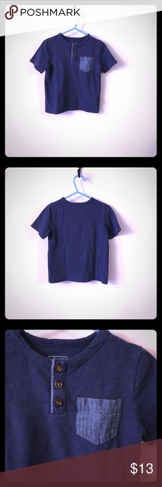"""Baby GAP 2T 100% cotton 1/2 button pocket t-shirt 📦Same day shipping (excluding Sun/holidays or orders placed after P.O. Closed) ❤️Save on shipping: Add all of your """"likes"""" to a bundle and submit an offer  Your little man will be comfy and adorable in this classic blue 1/2 button pocket t-shirt from Baby GAP. It is 100% cotton. The Shirt has 3 functional brown buttons & a denim accent chest pocket. The back of the Shirt is solid blue. Excellent condition: No holes or stains. Smoke/pet free…"""