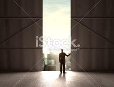 businessman open doors to hangar