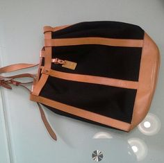 DOONEY & BOURKE  vintage rare back pack. Its a authentic classic bag , genuine leather with thick canvas.  Drawstring and back pack straps. Can be single or double shoulder . Spacious have a lot of space. Condition  like new. Its a classic vintage bag. Dooney & Bourke Bags Backpacks