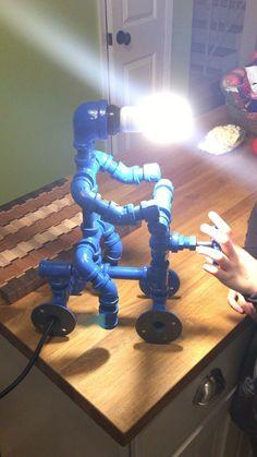 Gorgeous 35 Creative DIY Industrial Pipe Lamp Design Ideas Robot to Decor Your Home https://roomaniac.com/35-creative-diy-industrial-pipe-lamp-design-ideas-robot-decor-home/