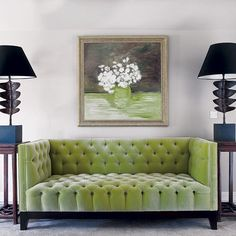 green tufted sofa.