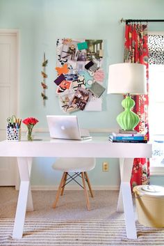 simlple colorful home office inspiration - such a clean desktop, how do you do that? where does your printer hide??