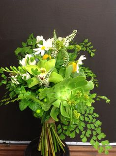 So that's what textural means! :) // Textural bouquet with lots of greens, ferns etc.   by Flower Jar
