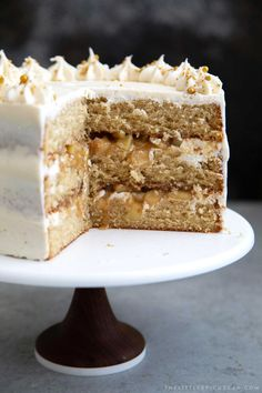 Yellow cake flavored with apple cider. Layered cake is filled with cooked apples and frosted with apple cider buttercream. Cake Apple Cider Layer Cake - The Little Epicurean Fall Desserts, Just Desserts, Delicious Desserts, Dessert Recipes, Layer Cake Recipes, Layer Cakes, Poke Cakes, Cold Cake, Cooked Apples