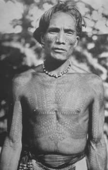 Kalinga bikking (chest tattoo), ca. 1900. This chief, as evident by his complex markings, took many a head. He is fortified in a tattooed skin of centipede scales (ufug).