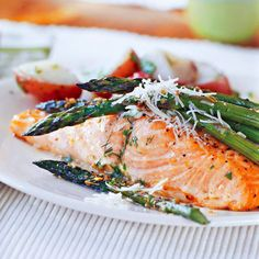 Basil-Buttered Salmon - For a summer-fresh twist on grilled salmon, brush on a mixture of warm melted butter, basil, parsley, and lemon peel. Serve it with crisp-tender asparagus.
