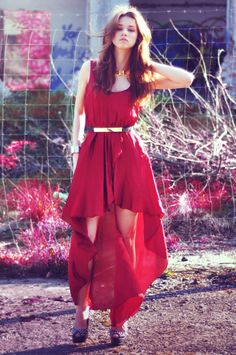 hi low dress. Red dress with black belt, gold jewelry and accessories.