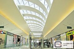 Acoustoic fabric and clouds installed at the Kyriat Ata Mall, Israel. #Clipso_Americas #AEROCEILING #ceiling_covering