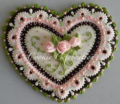 Pink and green lacy Valentine cookie by Cookie Celebration