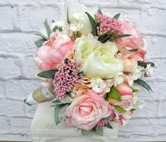 This romantic wedding bouquet is designed with cream & pink peonies with roses, on a bed of soft pink hydrangea, pretty pink ammi sprays throughout the bouquet add a lovely touch. Handle treatment is wrapped with burlap & lace, finished with pearl detail. Pictured bouquet measures: 10 ( 25 cm ) wide x 12 ( 30 cm ) tall. Coordinating boutonniere: https://www.etsy.com/listing/230575983/mens-silk-boutonniere-pink-peony?ref=shop_home_active_1  Wedding Bouquet...