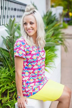Bringing the 80's back with the modern take on an a 80's pattern Classic Tee paired with a pop-of-color Cassie skirt.