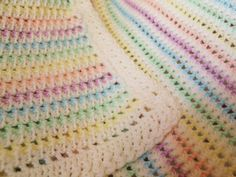 Pattern: Made in K-Town by Barbara The stitch-pattern is based on the Fantasy Shawl, a free vintage pattern. The adaption as a multi-colored baby blanket including border is my original design. Please