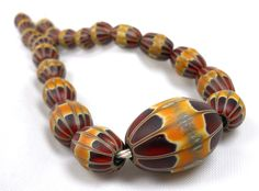 American Trade Bead - Massachusetts - Strand of 21 beads. Solid carved boro glass lampwork.. $255.00, via Etsy.