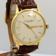 1956 Vintage International Watch Co. (IWC) Cal. 89 18k Yellow Gold watch with Silver Satin Dial with Applied Yellow Gold Bar Markers. Triple Signed. Swiss Case Very Good Case Original, Case Dimensions