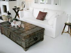 Love the vintage trunk coffee table