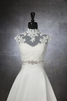Sincerity wedding accessories style A032 High neck lace and tulle button back jacket, with a beaded motif at the empire waist line.