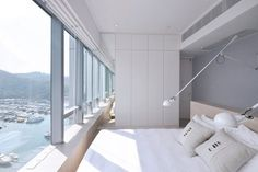 Bean Buro designed this apartment with large #panoramic #windows facing the sea boating sceneries, as a balanced and dynamic #home #office #bedroom