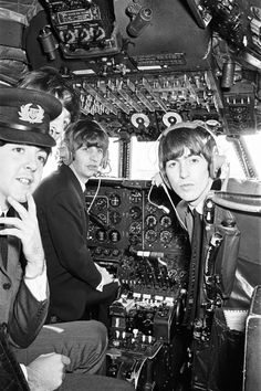 The Beatles flying an airplane to their next concert