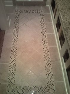 Tile Floor With Inlaid Design Leading To The Custom Shower