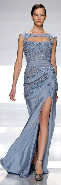 Love the dress. This model is entirely too skinny for this dress, there should be some serious cleavage and hour glass action going on. Someone give his girl a cheese cake and maybe some bacon stat.