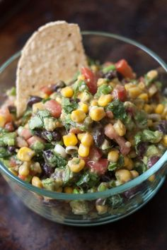 Ingredients 1- 15 oz can corn 1 can black beans 2 avocados (cubed) 2/3cup chopped cilantro 8 green onion stalks sliced 6 roma tomatoesDressing: 1/4 cup olive oil 1/4 cup red wine vinegar 2 cloves mincedgarlic 3/4 teaspoon salt 1/8 teaspoon pepper 1 teaspoon cumin Mix first6 ingredients together. Combine dressing ingredients and pour over cornmixture. Serve with tortilla chips..