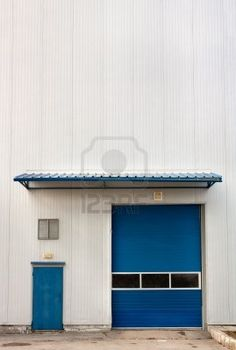 Picture of Industrial Warehouse Unit with blue roller shutter door Copy space stock photo, images and stock photography. Vintage Industrial Lighting, Industrial Door, Industrial Chic, Industrial Furniture, Roller Doors, Roller Shutters, Shutter Doors, Modern Retro, Glass Door