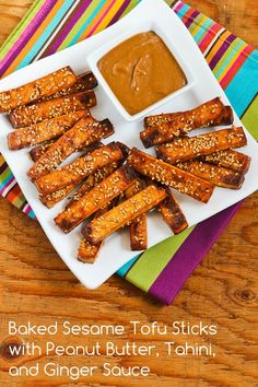 Baked Sesame Tofu Sticks with Peanut Butter, Tahini, and Ginger Sauce for a Meatless Monday dinner or snack.