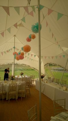 Interior capri wedding marquee, bunting, chinese pompoms shabby chic floral.