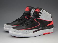 Air Jordan 2 Retro - Infrared 23 | The Air Jordan 2 Retro will be one of several 'Infrared 23' models released this year by the Jordan Brand.  The new look Air Jordan 2 Retro sports a full leather upper covered in black and grey, and is topped with classic Air Jordan speckle print. Borrowing the AJ VI's most recognizable design cue, we see infrared accenting throughout the AJ II's luxurious design. ( $TBA )