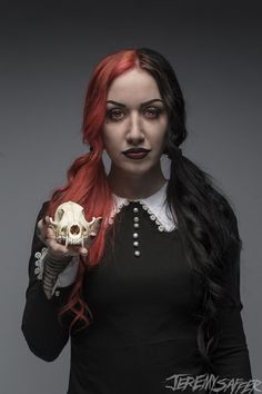 Ash Costello. She makes me miss my half and half hair :(