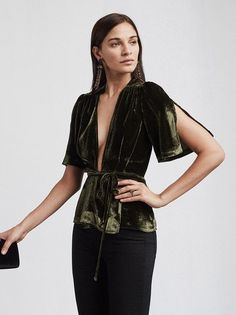Plunging velvet goes with everything. The Bara Top is a velvet wrap top with one of those deep V necklines you like. It's also got split short sleeves and gathered detailing at the shoulder.  https://www.thereformation.com/products/bara-top-neymar?utm_source=pinterest&utm_medium=organic&utm_campaign=PinterestOwnedPins